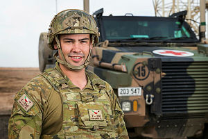Australian Army soldier Corporal Levi Stripp is serving with Task Group Taji 4 at Taji Military Complex, Iraq. He is seen here with a Bushmaster Protected Mobility Vehicle - Ambulance.