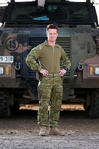Australian Army officer Major Brian Hickey, from Task Group Taji 4, is seen in front of an Australian Bushmaster protected mobility vehicle at Taji Military Complex, Iraq.