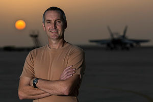 Royal Australian Air Force Avionics Technician Sergeant Peter Knezevic stands on the flight line at sunset during his Operation OKRA deployment at the main air operating base in the Middle East Region.