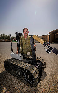 Royal Australian Air Force Warrant Officer Rodney Amos with a Talon Explosive Ordinance Disposal Robot at Australia's main operating base in the Middle East region.