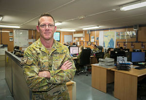 Royal Australian Air Force airman Corporal Ben Reed, from Gympie, stands inside the orderly room at Australia's main operating base in the Middle East region.