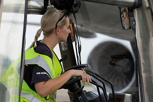 Royal Australian Air Force Leading Aircraftwoman Olm drives a forklift near a Royal New Zealand Air Force Boeing 757-200 after it lands at RMAF Butterworth, Malaysia for exercise Bersama Shield 2017.