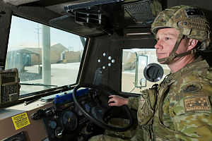 Australian Army soldier Corporal Nathan Mclean, deployed with Task Group Taji 4, drives a Unimog at the Taji Military Complex in Iraq.