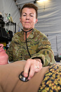 Australian Army officer Dianne Hutchinson of Task Group Taji 5 checks the breathing rate during training at the Camp Taji Clinic located at the Taji Military Complex, Iraq.