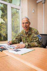 Public Affairs and Information Operations Advisor, Australian Army Major Andrew Leong, works in the Australian Headquarters at the Kabul Garrison General Command in Kabul, Afghanistan.