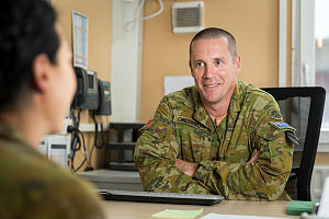 Chief of Staff of Task Group Afghanistan, Australian Army Lieutenant Colonel Neil Grierson, works in his office at Hamid Karzai International Airport in Kabul, Afghanistan.