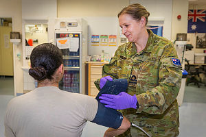 Navy Lieutenant Lauren Keany measures a patient's blood pressure in the NATO Hospital at Hamid Karzai International Airport in Kabul, Afghanistan.