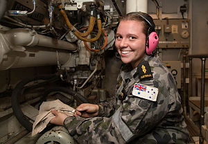 Able Seaman Marine Technician Katrina Harris conducts an oil level check in HMAS Newcastle's propulsion diesel engine in the Middle East region.