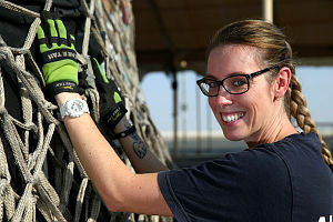 Royal Australian Air Force Corporal Kyra Poole, a movements specialist, checks a load of cargo before it's shipped from Australia's main base in the Middle East