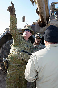 Australian Army Warrant Officer Class Two Ken Roberts conducts an inspection of a crane as part of his role as the Command Sergeant Major for Task Group Taji 6 Logistics Company.
