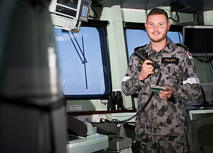 Able Seaman Communication and Information Systems Jake Collett monitors communication systems on the bridge of HMAS Warramunga during the ship's deployment to Operation Manitou.