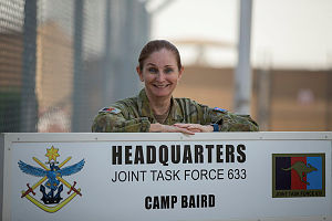 COL Jenny Cotton in front of the Joint Task Force 633 Headquarters in the Middle East.