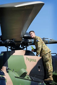 Australian Army Aircraft Technician Craftsman Andrew Cooper inspects a Multi Role Helicopter (MRH90) aircraft main rotor blade after a familiarisation training flight for the 2018 Commonwealth Games.