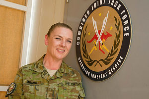 Royal Australian Air Force airwoman Sergeant Kerri Adams, of the Air Intelligence Training Unit, provides administrative support to about 25 Australians working with the operational headquarters of Combined Joint Task Force - Operation Inherent Resolve at the main coalition base near Iraq.