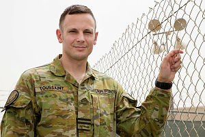 Royal Australian Air Force officer Flight Lieutenant Shaun Toussaint, of Number 22 Squadron, is combining his civilian and military logistic skills while deployed to the Middle East on Operation Okra.