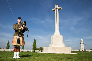 Australian Army soldier Musician Shaun Manning practices piping The Lament at the Villers-Bretonneux Military Cemetery (front) in France, in the lead up to the 2018 Anzac Day Dawn Service at the Australian National Memorial (tower in rear).