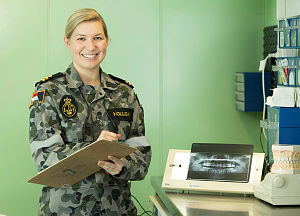 Royal Australian Navy Dentist, Lieutenant Lisa Holliday, in the dental hospital of HMAS Adelaide during Indo-Pacific Endeavour 2018.