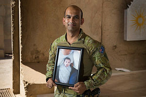 Australian Army officer, Major Varun Singh, with a photo of his son, at Taji Military Complex, Iraq.