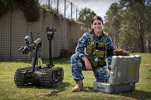 Air Force Explosive Ordnance Reconnaissance Technician, Leading Aircraftwoman Beth Magner, employs the MTRS TALON4, a remotely piloted vehicle, during Exercise Regal Burrow at Defence Establishment Orchard Hills.