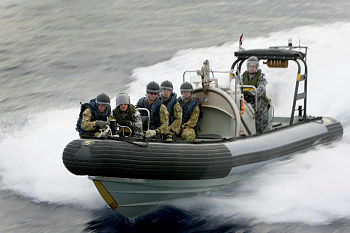 Members of Transit Security Element 57, from 1 Platoon 'A' Commpany 8/9 RAR, conduct Rigid Hull Inflatable Boat (RHIB) Training with members of ASSAIL TWO whilst aboard HMAS BROOME during an Operation RESOLUTE Patrol.