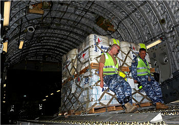 Pallets of Australian Aid (blankets, tarpaulins, hygiene kits and water purification tablets) are loaded onto a No. 36 Squadron C-17A Globemaster aircraft in preparation for delivery to Nepal.
