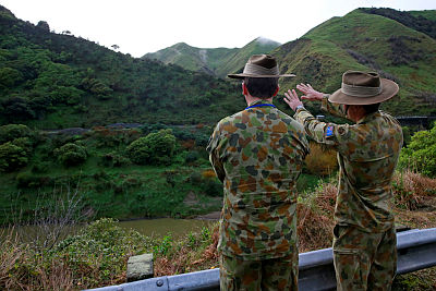 (From left) Captains Gavin Cookman and James Sheppard assess the lie of the land during a field trip to near Norsewood, New Zealand. The site visit was held to allow exercise particpants to better appreciate the tasks they are planning for the upcoming Command Post Exercise phase of Exercise Suman Warrior 14.