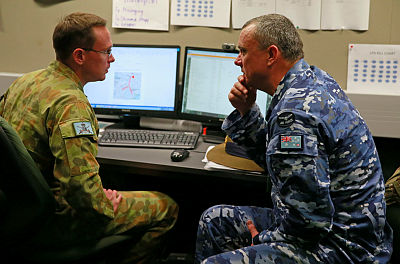Air Commodore Ken Quinn (right), Director General - Engagements and Assessment, chats with Major Adam Sparkes during Exercise Suman Warrior 2014 at Linton Military Camp, NZ.