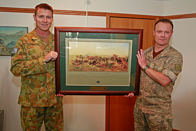 Commander Australian Contingent, Lieutenant Colonel Peter Conroy presents 1 New Zealand Brigade Commander, Colonel Nick Gillard with a framed print at Linton Military Camp, NZ.
