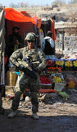 Private Dean Patrao from 7th Battalion Royal Australian Regiment Task Group's Other Government Agencies Platoon provides security to a Provincial Reconstruction Team inspection of a bridge at Sarkhum in Uuzgan province.